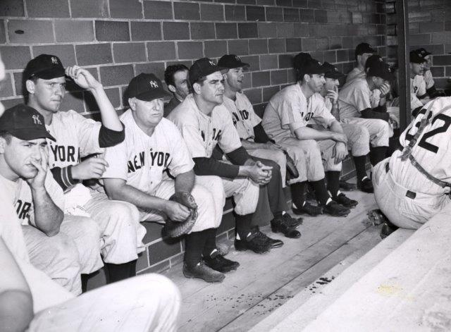 Rookie Yogi Berra on left, Joe DiMaggio near center - Yankee dugout 1947